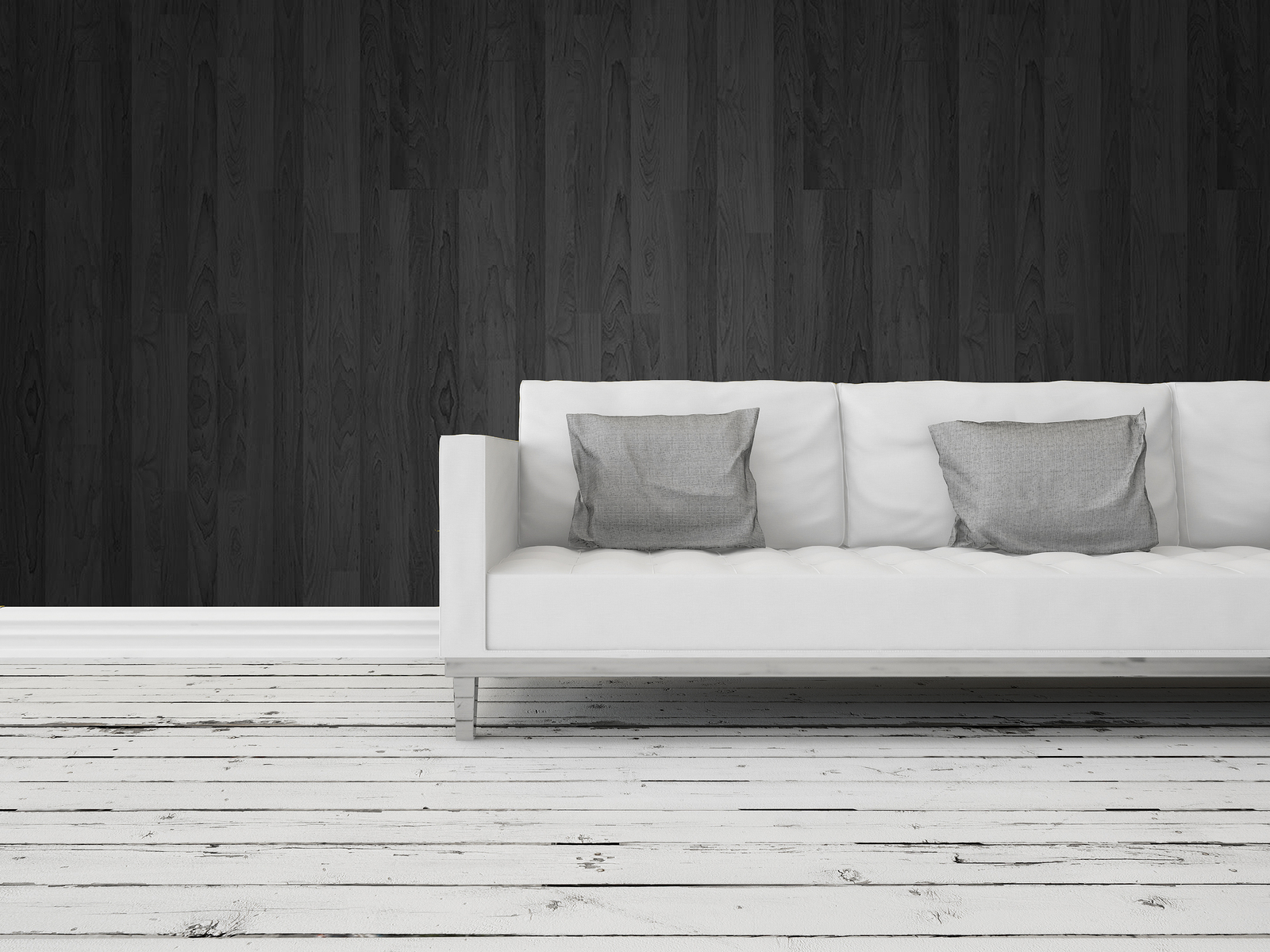 Black and white interior decor background with a generic modern white sofa against a dark wall with grungy rustic weathered wooden white painted floor boards